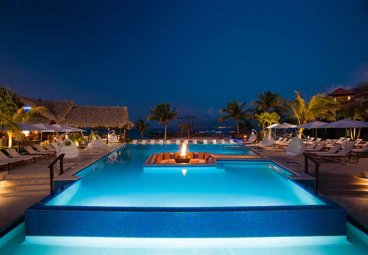 Sandals Pool with infiity edges and sunken seating with firepit - Saint George, Grenada