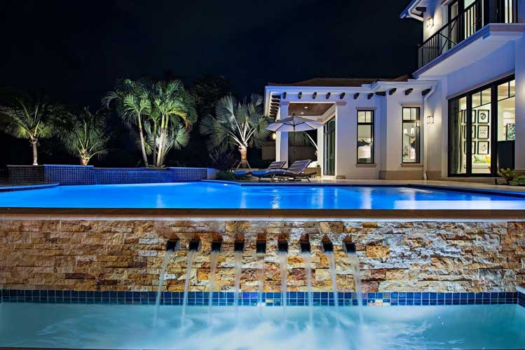 View across pool from sunken seating are in an Estate lot in Estuary - Naples, Florida